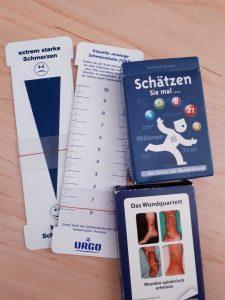 Urgo Schmerzskalen und Kartenspiele